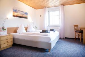 Ein Bett oder Betten in einem Zimmer der Unterkunft Gasthof Knupfer