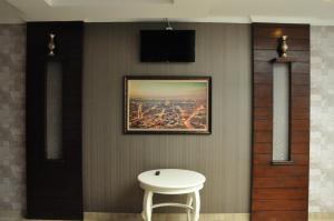 A television and/or entertainment center at Casa de Wanea Hotel