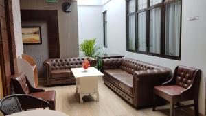 A seating area at Casa de Wanea Hotel