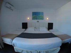 A bed or beds in a room at Hotel Natursun