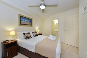 A bed or beds in a room at Seascape Holidays - 30 Mahogany Sands