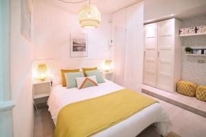 Cama o camas de una habitación en Apartamento con jardín privado