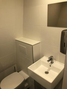 A bathroom at Hotel 55 - City Centre