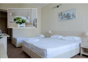 Кровать или кровати в номере Гостевой Дом Аква-Солярис