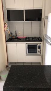 A kitchen or kitchenette at Um lugar especial para sua estadia em Brasília