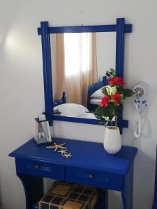 Ένα ή περισσότερα κρεβάτια σε δωμάτιο στο Aiantas