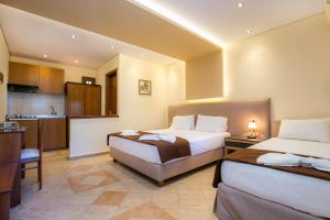 A bed or beds in a room at Villa Katerina