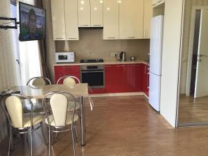 A kitchen or kitchenette at Apartments Zoya