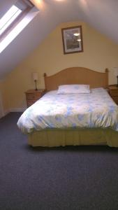 A bed or beds in a room at All Seasons Guest House