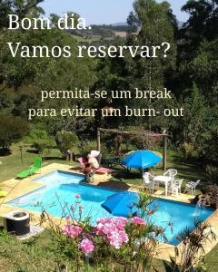 Uma vista da piscina em Pousada e Spa Holístico Luz e Paz ou nos arredores