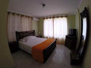 Una cama o camas en una habitación de Zippy´s Sea View Apartments