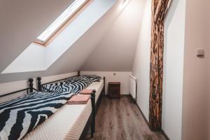 Postel nebo postele na pokoji v ubytování Vila u Arény