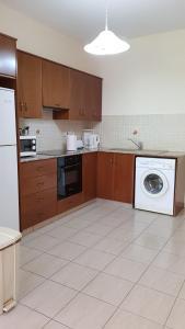 A kitchen or kitchenette at Lazaros Pissouri Apartments
