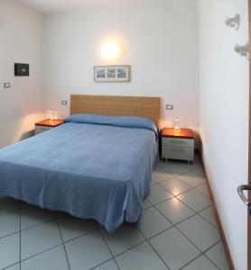 Postel nebo postele na pokoji v ubytování Residence Torre di Noe