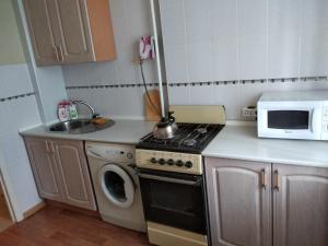 Кухня или мини-кухня в гостиница Иловлинская