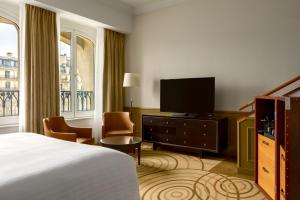 A television and/or entertainment center at Paris Marriott Champs Elysees Hotel