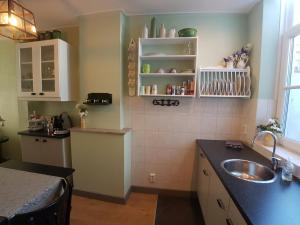 A kitchen or kitchenette at CITY HOUSE Bed by the Sea