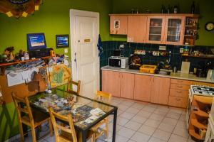 A kitchen or kitchenette at Mandala Hostel