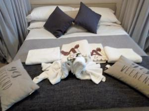 A bed or beds in a room at Albergo Aquila