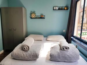 A bed or beds in a room at Urban Vibes Guesthouse