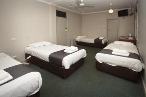 A bed or beds in a room at The George Hotel