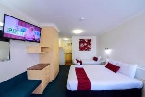 A bed or beds in a room at Aspley Motor Inn