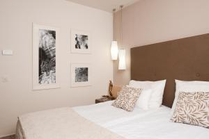 Ein Bett oder Betten in einem Zimmer der Unterkunft Grand Hotel Sava Superior