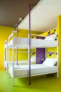 A bunk bed or bunk beds in a room at We_Bologna