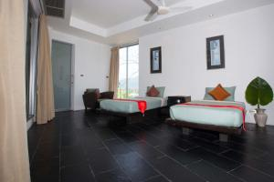 A bed or beds in a room at The Coolwater Resort & Villas