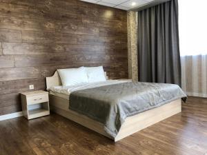 Кровать или кровати в номере New City Inn