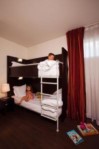 Un ou plusieurs lits superposés dans un hébergement de l'établissement Residhome Val d'Europe