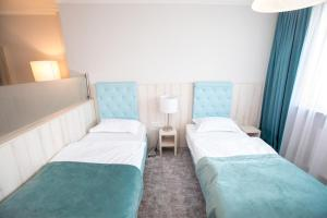 A bed or beds in a room at Hotel Amts-Apotheke