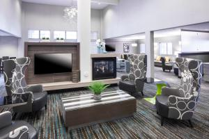A seating area at Residence Inn by Marriott Near Universal Orlando