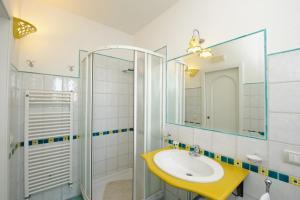 A bathroom at Eva Rooms