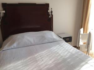 A bed or beds in a room at Tavira Castelo-center-2 bedrooms