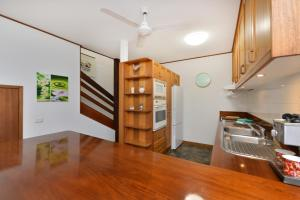 A kitchen or kitchenette at Drifting Port Douglas