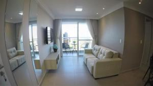 A seating area at My Way Meireles By DM Apartments