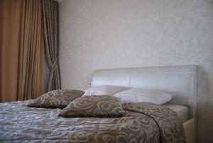 Кровать или кровати в номере Апартамент на Курортном