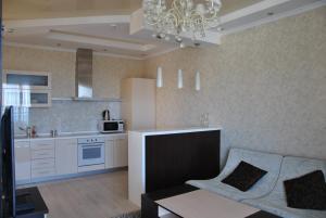 Кухня или мини-кухня в Апартамент на Курортном