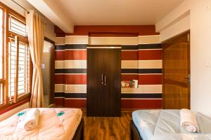 A bed or beds in a room at Zostel Kathmandu