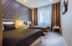 Кровать или кровати в номере Виктория Плаза
