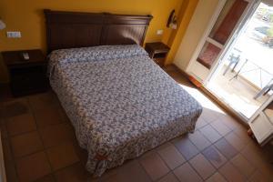 Cama o camas de una habitación en La Palmosa