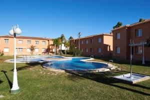 Het zwembad bij of vlak bij Apartamentos y Villas Oliva Nova Golf Resort