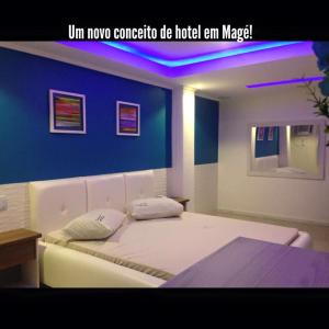 A bed or beds in a room at Hotel Vagalume