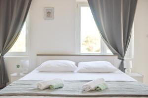 A bed or beds in a room at Mocire Zadar