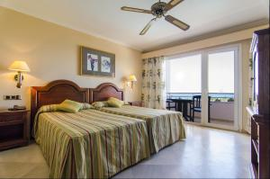 A bed or beds in a room at Marbella Playa Hotel