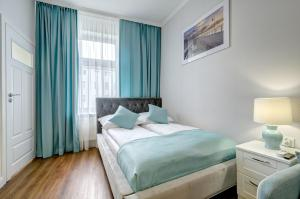 A bed or beds in a room at 3 City Apartments - Solaro