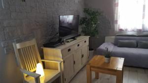 TV a/nebo společenská místnost v ubytování Pinta