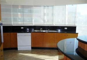 A kitchen or kitchenette at One Darling 109
