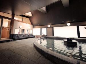 The swimming pool at or near Hotel Route-Inn Gotanda
